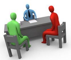 three people at a desk