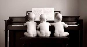 3 babies at piano