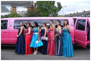bridal party near pink limo